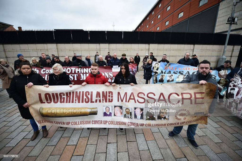 Loughinisland victim protestors stand alongside Ballymurphy victim supporters at Belfast High Court on January 12, 2018 in Belfast, Northern Ireland. The judge has delayed his ruling on a police ombudsman's report into the murders of six catholic men in 1994 who were shot by loyalist gunmen as they watched a World Cup football match in the Heights Bar in Loughinisland. In June 2016, the police ombudsman ruled there had been collusion between some police officers and the gunmen however in December, a judge ruled that conclusion was 'unsustainable in law'. The case is adjourned until next week following a late change in the police ombudsman's legal team.