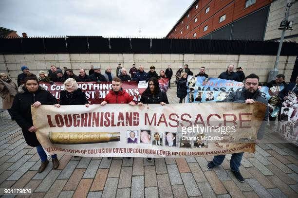 Loughinisland victim protestors stand alongside Ballymurphy victim supporters at Belfast High Court on January 12 2018 in Belfast Northern Ireland...
