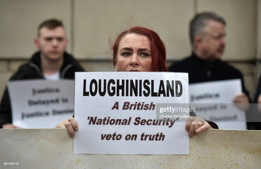 Loughinisland victim protestors stand with placards and banners outside Belfast High Court on January 12, 2018 in Belfast, Northern Ireland. The judge has delayed his ruling on a police ombudsman's report into the murders of six catholic men in 1994 who were shot by loyalist gunmen as they watched a World Cup football match in the Heights Bar in Loughinisland. In June 2016, the police ombudsman ruled there had been collusion between some police officers and the gunmen however in December, a judge ruled that conclusion was 'unsustainable in law'. The case is adjourned until next week following a late change in the police ombudsman's legal team.