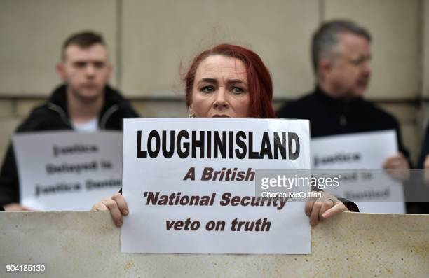 Loughinisland victim protestors stand with placards and banners outside Belfast High Court on January 12 2018 in Belfast Northern Ireland The judge...