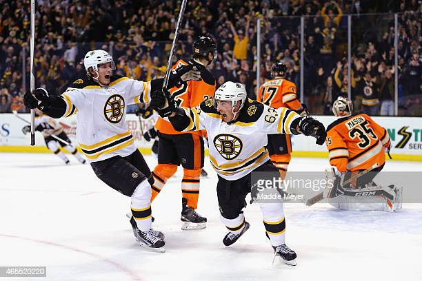 Loui Eriksson congratulates Brad Marchand of the Boston Bruins after he scored a goal in the third period against the Philadelphia Flyers sending the...