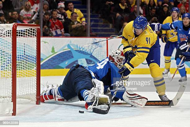 Loui Eriksson of Sweden scores a goal in the second period against Miikka Kiprusoff of Finland during the ice hockey men's preliminary game on day 10...