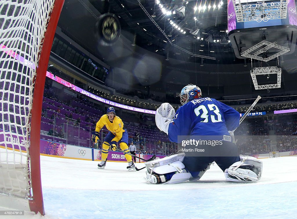 Loui Eriksson #21 of Sweden shoots and scores against Robert Kristan #33 of Slovenia in the third period during the Men's Ice Hockey Quarterfinal Playoff on Day 12 of the 2014 Sochi Winter Olympics at Bolshoy Ice Dome on February 19, 2014 in Sochi, Russia.
