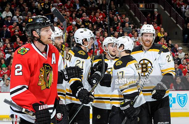 Loui Eriksson of the Boston Bruins celebrates with teammates including Dougie Hamilton after scoring Boston's second goal in the first period as...