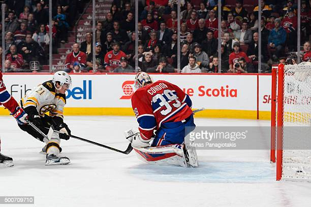 Loui Eriksson of the Boston Bruins scores a shorthanded goal on goaltender Mike Condon of the Montreal Canadiens during the NHL game at the Bell...