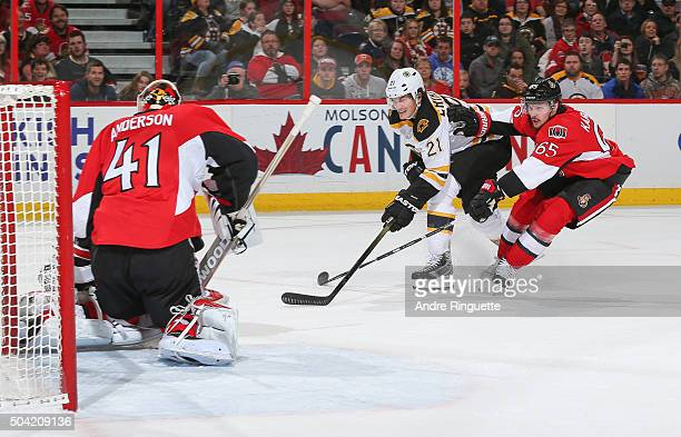 Loui Eriksson of the Boston Bruins shoots the puck a scoring chance against Craig Anderson and Erik Karlsson of the Ottawa Senators at Canadian Tire...
