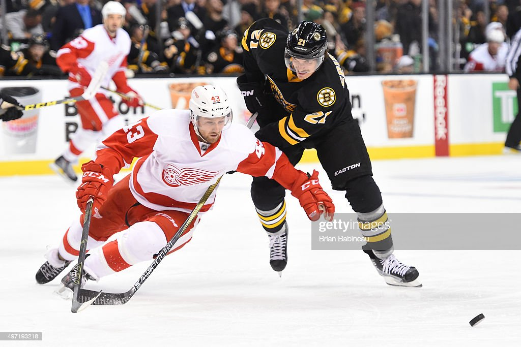 online store 55fe6 f3055 Loui Eriksson of the Boston Bruins skates against Darren ...