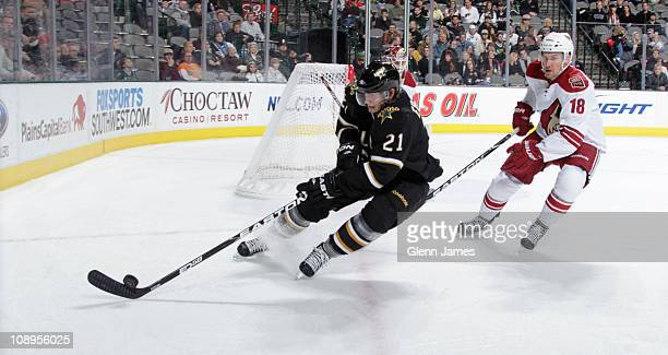 Loui Eriksson of the Dallas Stars moves the puck against Sami Lepisto of the Phoenix Coyotes at the American Airlines Center on February 9 2011 in...