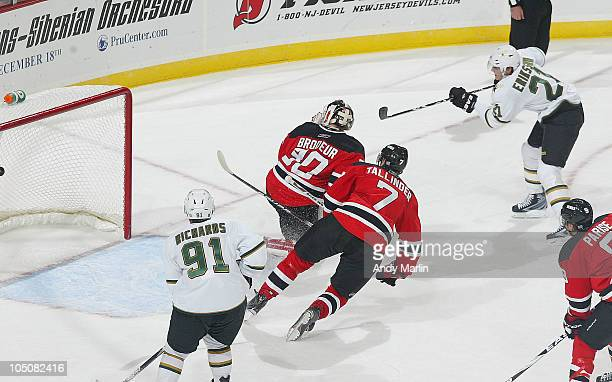 Loui Eriksson of the Dallas Stars puts the puck past Martin Brodeur of the New Jersey Devils for the winning goal in overtime during the 2010 season...