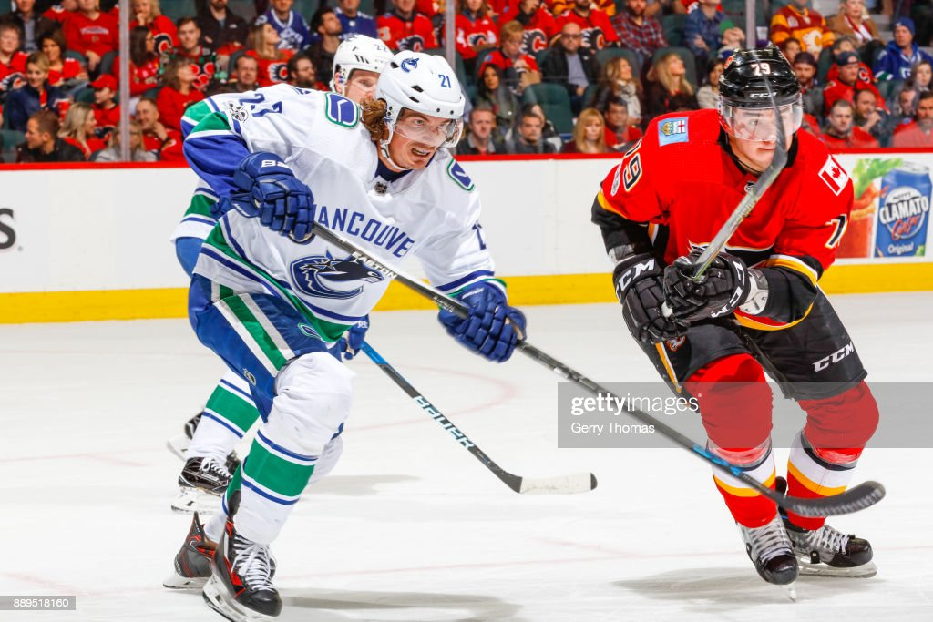 Loui Eriksson #21 of the Vancouver Canucks and Micheal Ferland #79 of the Calgary Flames in a NHL game against the Vancouver Canucks at the Scotiabank Saddledome on December 09, 2017 in Calgary, Alberta, Canada.