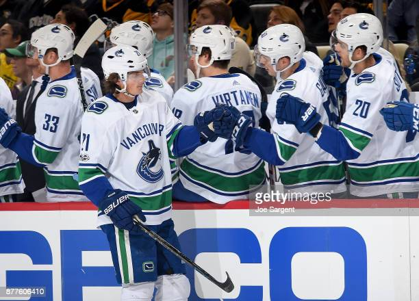 Loui Eriksson of the Vancouver Canucks celebrate his first period goal against the Pittsburgh Penguins at PPG Paints Arena on November 22 2017 in...