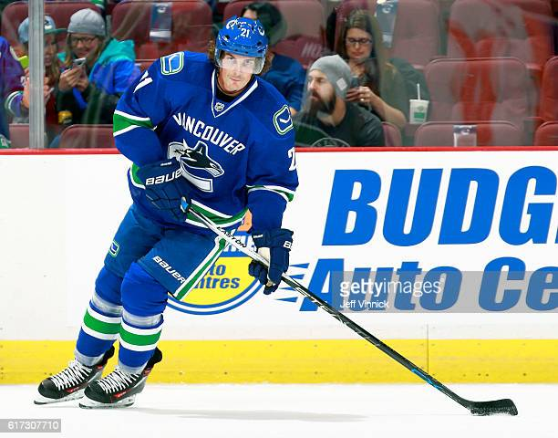 Loui Eriksson of the Vancouver Canucks skates up ice with the puck during their NHL game against the Carolina Hurricanes at Rogers Arena October 16...