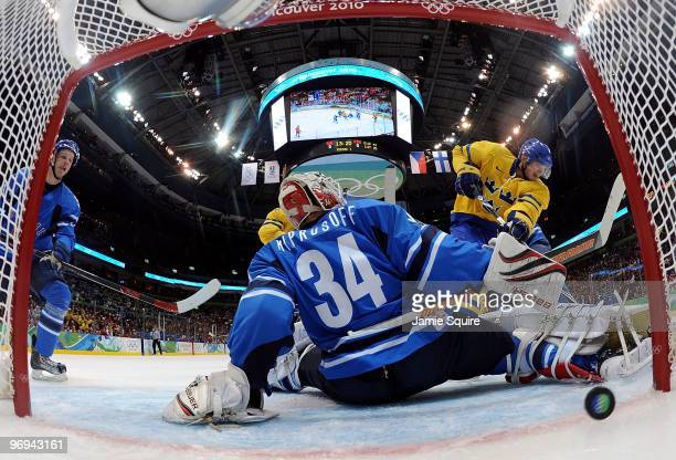 Loui Eriksson Sweden scores a goal past against Miikka Kiprusoff of Finald during the ice hockey men's preliminary game on day 10 of the Vancouver...