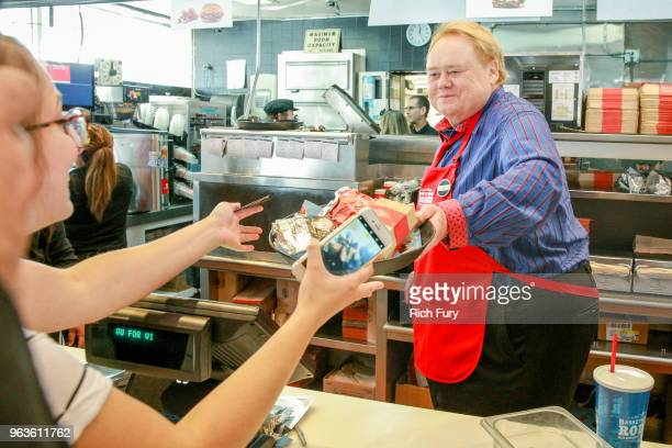 Louie Anderson serves customers during the FYC event for FX's 'Baskets' at Arby's on May 29 2018 in Los Angeles California