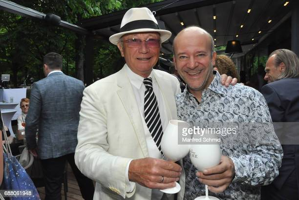 Louie Austen and Andy Lee Lang pose during the 'Die Allee zum Genuss' restaurant opening party on May 24, 2017 in Vienna, Austria.