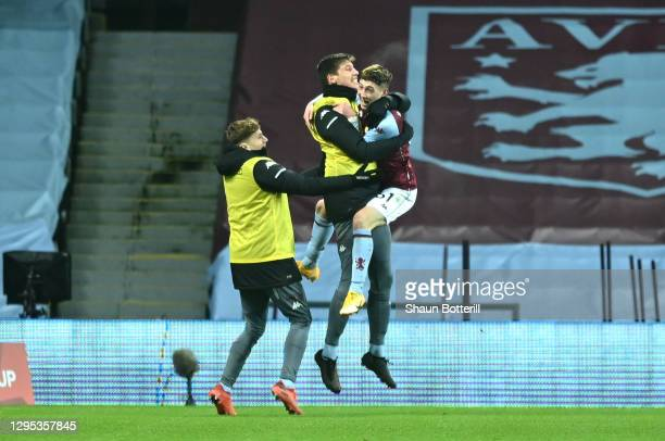 Louie Barry of Aston Villa celebrates after scoring their sides first goal with players from the bench during the FA Cup Third Round match between...