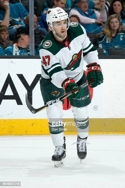 Louie Belpedio of the Minnesota Wild passes the puck during a NHL game against the San Jose Sharks at SAP Center on April 7 2018 in San Jose...