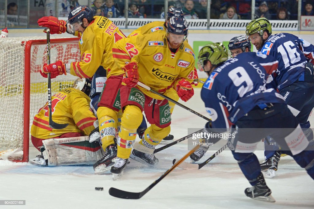 Louie Caporusso of Iserlohn and Goalkeeper Daniel Bakala of Duesseldorf battle for the ball during the DEL match between Iserlohn Roosters and Duesseldorfer EG at Eissporthalle Iserlohn on January 12, 2018 in Iserlohn, Germany.
