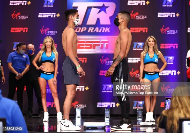 Louie Coria and Jose Enrique Vivas face-off during the weigh-in at Virgin Hotels Las Vegas on May 21, 2021 in Las Vegas, Nevada.