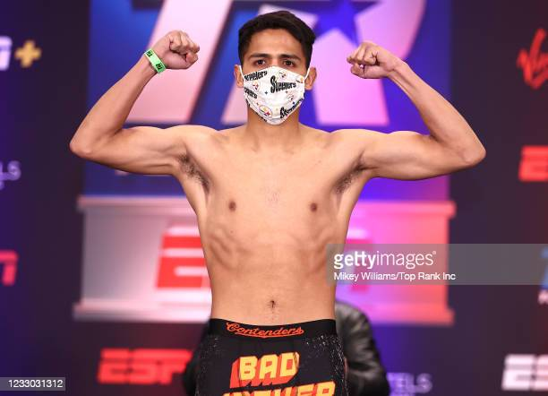 Louie Coria flexes on the scale ahead of his fight with Jose Enrique Vivas at Virgin Hotels Las Vegas on May 21, 2021 in Las Vegas, Nevada.