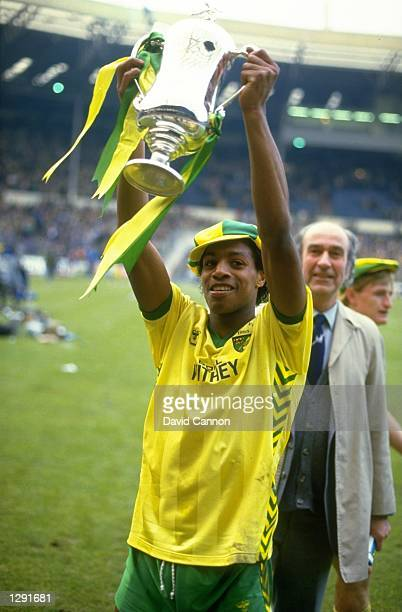 Louie Donowa of Norwich City raises the trophy aloft after their victory in the Milk Cup Final against Sunderland at Wembley Stadium in London...