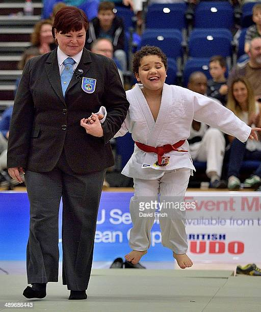 Louie leaps excitedly as he is led on to the mat by Helen Davies for his Beat a Black Belt display during the London British Open Senior European...