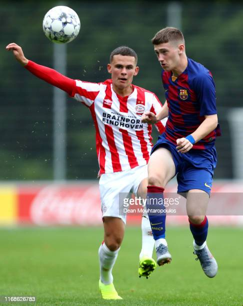 Louie Mark Barry of FC Barcelona battles for the ball with Joost de Schutter of PSV during The Otten Cup match between PSV Eindhoven and FC Barcelona...