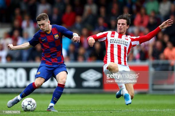 Louie Mark Barry of FC Barcelona shoots on goal in front of Mees Kreekels of PSV during The Otten Cup match between PSV Eindhoven and FC Barcelona...