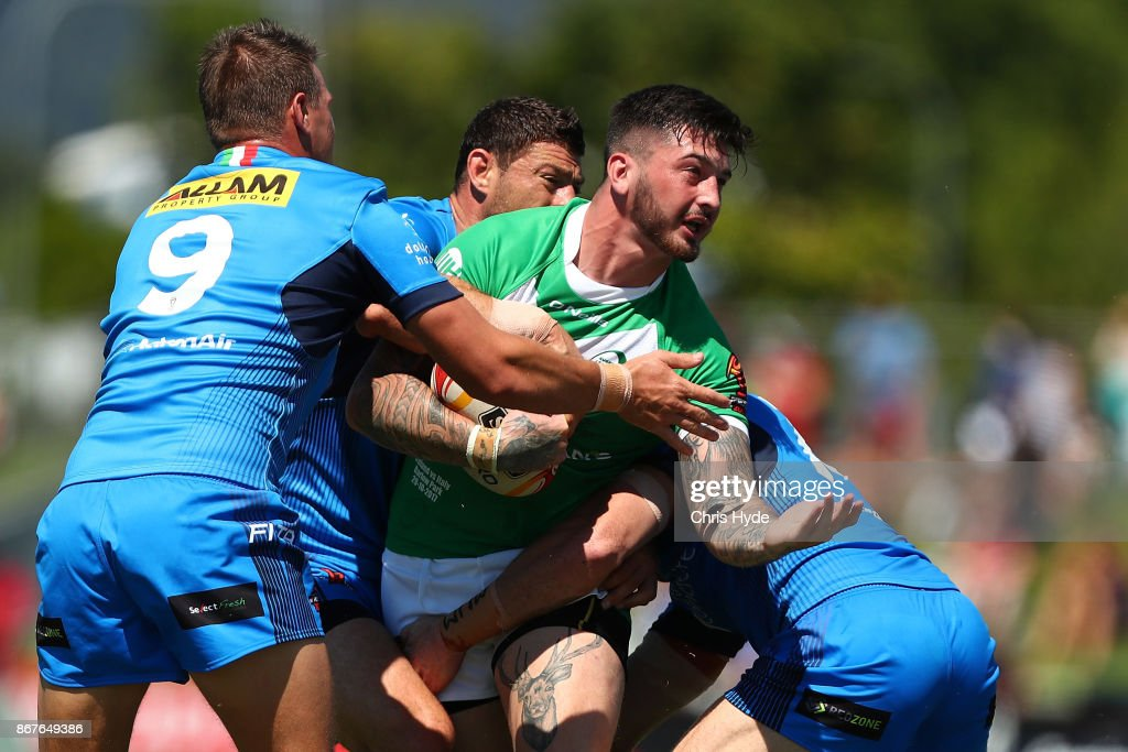 Louie McCarthy-Scarsbrook of Ireland is tackled during the 2017 Rugby League World Cup match between Ireland and Italy at Barlow Park on October 29, 2017 in Cairns, Australia.