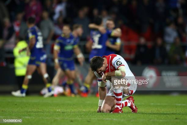 Louie McCarthyScarsbrook of St Helens drops to his knees as Warrington Wolves celebrate at the final whistle during the BetFred Super League semi...