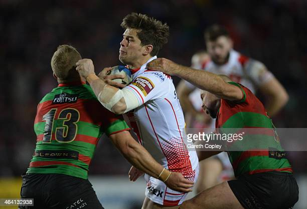 Louie McCarthyScarsbrook of St Helens is tackled by Jason Clark and Glenn Stewart of South Sydney Rabbitohs during the World Club Challenge match...