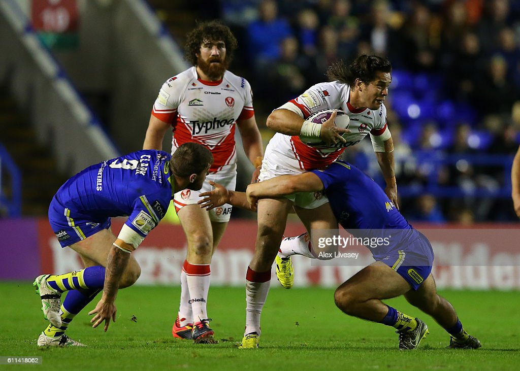 Louie McCarthy-Scarsbrook of St Helens is tackled by Sam Wilde of Warrington Wolves during the First Utility Super League Semi Final match between Warrington Wolves and St Helens at The Halliwell Jones Stadium on September 29, 2016 in Warrington, England.