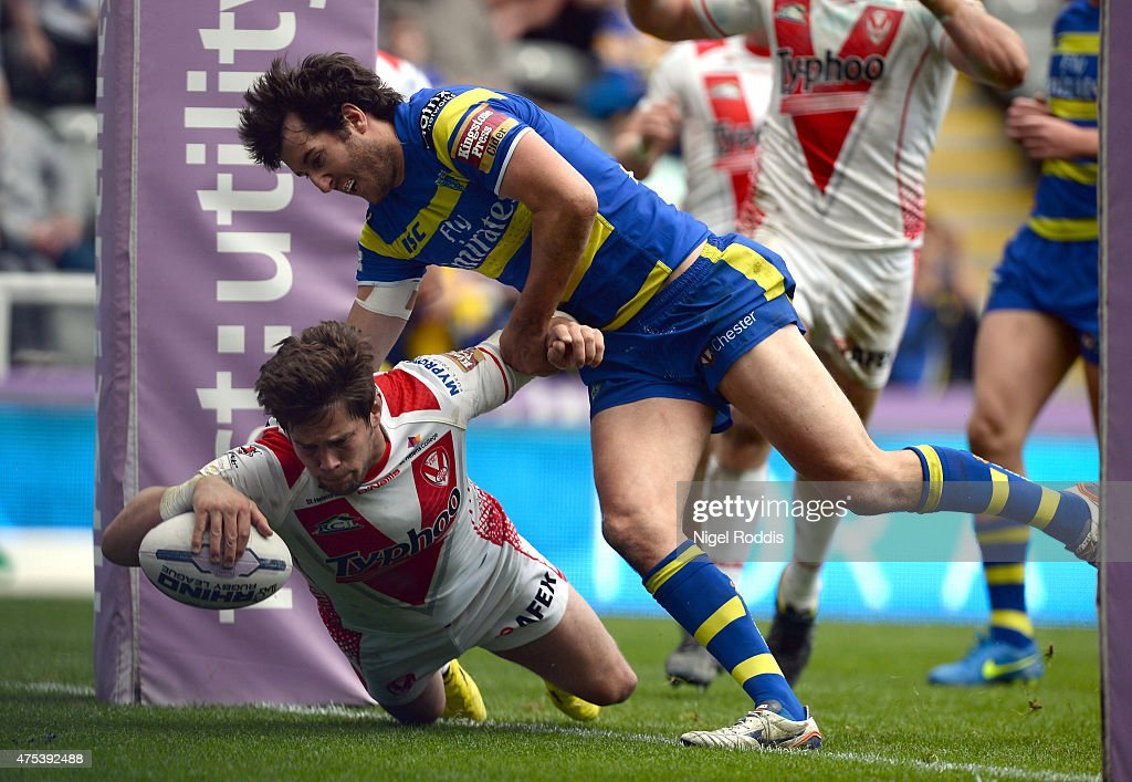 Louie McCarthy-Scarsbrook (L) scores a try during the Super League match between St Helens and Warrington Wolves at St James' Park on May 31, 2015 in Newcastle upon Tyne, England.