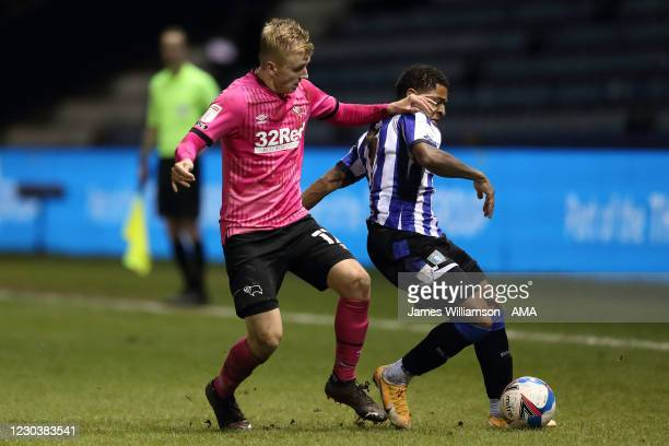 Louie Sibley of Derby County and Moses Odubajo of Sheffield Wednesday during the Sky Bet Championship match between Sheffield Wednesday and Derby...