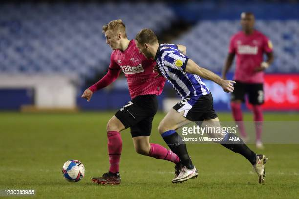 Louie Sibley of Derby County and Tom Lees of Sheffield Wednesday during the Sky Bet Championship match between Sheffield Wednesday and Derby County...