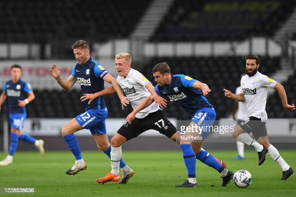 Louie Sibley of Derby County battles with Paul Huntington of Preston and Paul Gallagher of Preston during the Carabao Cup match between Derby County...