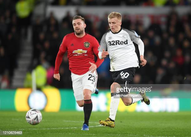 Louie Sibley of Derby County is closed down by Luke Shaw of Manchester United during the FA Cup Fifth Round match between Derby County and Manchester...