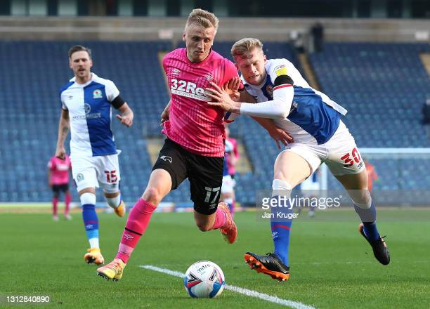 Louie Sibley of Derby County is tackled by Jarrad Branthwaite of Blackburn Rovers during the Sky Bet Championship match between Blackburn Rovers and...