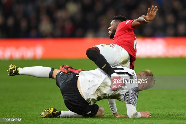 Louie Sibley of Derby County tackles Fred of Manchester United during the FA Cup match between Derby County and Manchester United at the Pride Park...