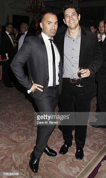 Louie Spence and Adam Garcia attend an after party following Press Night of 'Driving Miss Daisy' at the RAC Club on October 5 2011 in London England