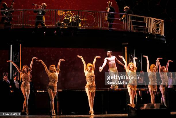 Louis A Williams Jr bare chest joins other dancers in a scene from Los Angeles Opera's production of Verdi's La Traviata at the Dorothy Chandler...