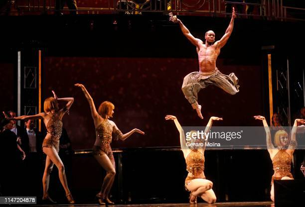 Louis A Williams Jr in air joins dancers in a scene from Los Angeles Opera's production of Verdi's La Traviata at the Dorothy Chandler Pavilion in...