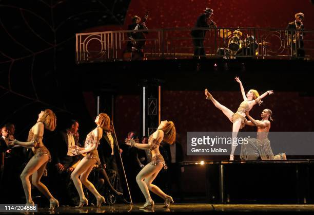 """Louis A. Williams, Jr., right, and Breanne Wilson join other dancers in a scene from Los Angeles Opera's production of Verdi's """"La Traviata,"""" at the..."""
