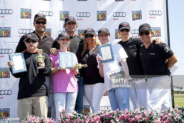Louis Aguirre Anthony Kennedy Shriver Melissa Ganzi Anja Kaehny and Marc Ganzi with winner 'buddies' attend the Audi Best Buddies Polo Experience at...