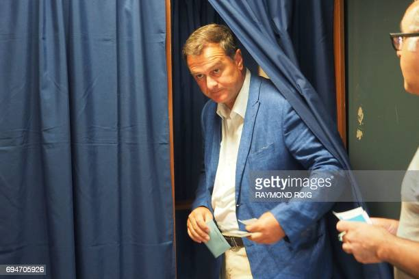 Louis Aliot candidate of the far right National Front party in the 2nd district of the Pyrenees orientales walks out a polling booth at a polling...