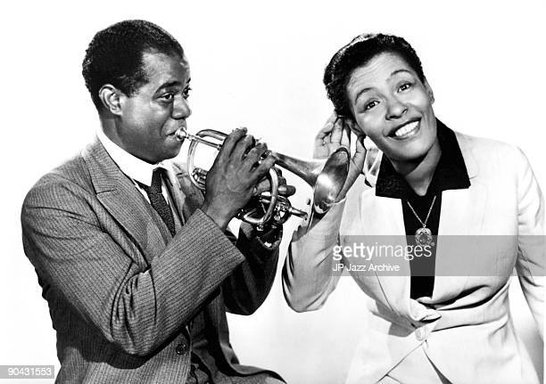 Louis Armstrong and Billie Holiday pose together for a studio portrait c 1939.