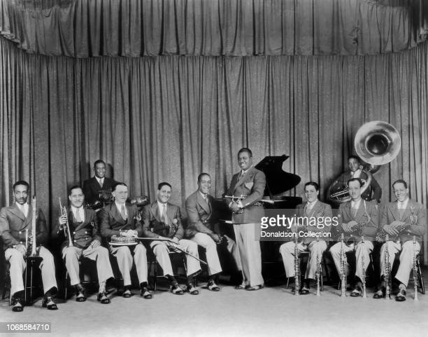 Louis Armstrong And His Orchestra pose for a portrait, circa 1934, New York City, New York.