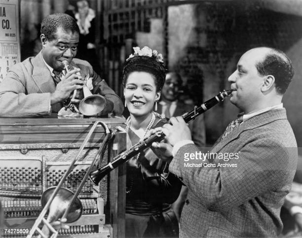 Louis Armstrong Billie Holiday and Barney Bigard perform on the set of the musical 'New Orleans' in 1947 in New Orleans Louisiana Billie Holiday...