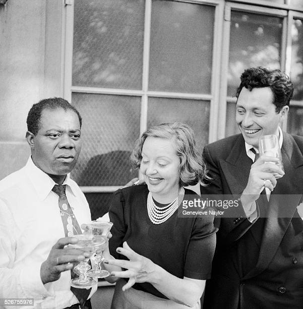 Louis Armstrong celebrates his 50th Birthday with Tallulah Bankhead and Bill Langford on the terrace of Bankhead's New York City apartment