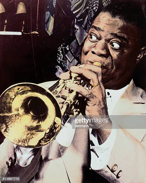 Louis Armstrong plays his trumpet during a performance in Baltimore